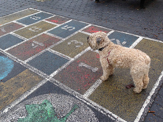 Ella's playing hopscotch