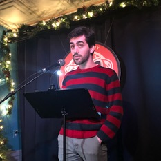 Emre Tetik reads at Line Break #25 - click to view - mousewheel to zoom